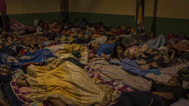Migrants from Honduras rest in Guatemala City, Wednesday, Oct. 17, 2018. In open defiance of the Mexican and American governments, thousands of Central American undocumented migrants, part of a caravan that has been heading toward the United States for more than a week, resumed their journey on Sunday in southern Mexico. (Daniele Volpe/The New York Times)
