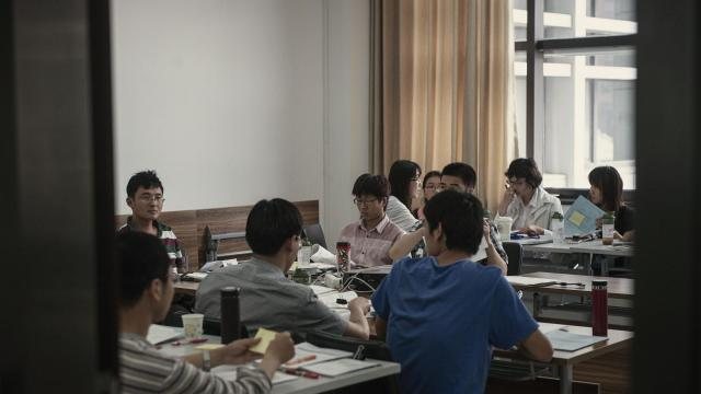 FILE-- Students in a class at Renmin University in Beijing, May 31, 2013. Faculty members at Cornell University said on Oct. 29, 2018, that they were cutting ties with the leading Chinese university after reports that it was harassing and intimidating students leading a campaign for workers' rights. (Gilles Sabrie/The New York Times)