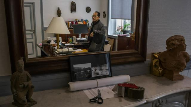 """Michel Cocotier, the principal of a Nantes high school who also heads the group Memories from Overseas, which pressed the city to memorialize its slave trading history, at his office in Nantes, France, June 14, 2018. """"The slave trade was hidden for a long time,"""" said Cocotier. Nantes played a major role in the European slave trade. Its museum and memorial are a model for other French cities grappling with their histories. (Mauricio Lima/The New York Times)"""