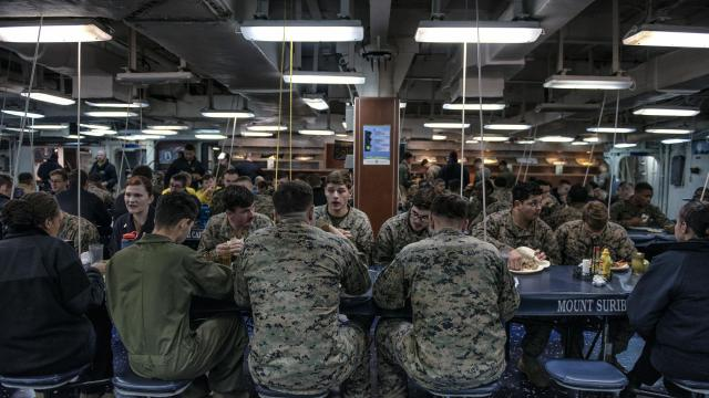 The mess deck of the USS Iwo Jima during NATO's Trident Juncture exercises, off the coast of Norway, Oct. 26, 2018. One of NATO's largest exercises since the end of the Cold War is focused on cold-weather combat preparedness, something American troops have little experience with. (Laetitia Vancon/The New York Times)