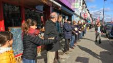 IMAGES: A Store Had to Move Thousands of Books. So a Human Chain Was Formed.