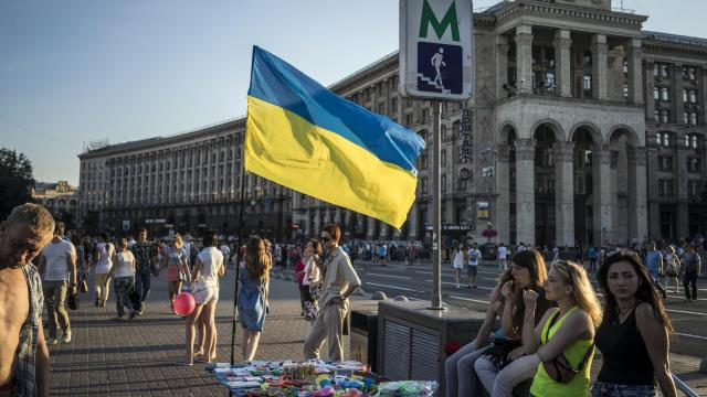 FILE -- A Ukranian flag flies in downtown Kiev, June 28, 2017, The bitter relations between Moscow and Kiev have continued their downward spiral, as the Russian government imposed economic sanctions against a broad cross-section of Ukraine's political and business elite. (Brendan Hoffman/The New York Times)