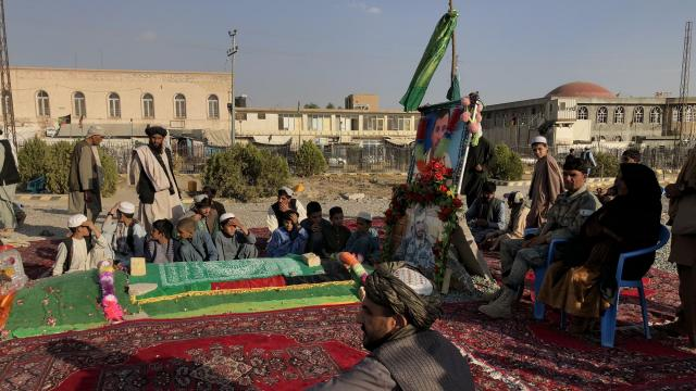 Mourners at the grave of Gen. Abdul Raziq, one of the Afghan army's top generals, in Kandahar, Oct. 25, 2018. In his rise from lowly border guard to larger-than-life security chief in a little over a decade, Raziq built nothing less than an empire in southern Afghanistan. He was assassinated by a Taliban operative on Oct. 18, 2018. (Mujib Mashal/The New York Times)
