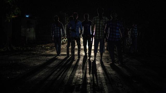 FILE -- Villagers patrol at night for the tiger thought to have killed 13 people in Vihirgaon, India, Sept. 5, 2018. The man-eating tiger was felled by a bullet on Friday night, November 2, 2018, officials said. The female tiger was the subject of one of the longest and most expensive tiger hunts in India in recent memory. (Bryan Denton/The New York Times)