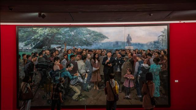 President Xi Jinping front and center while a statue of Deng Xiaoping is a distant image in a painting at the Guangdong Museum of Art in Guangzhou, China, Sept. 19, 2018. In a significant propaganda shift, Xi Jinping's rise has come at the expense of Deng Xiaoping, long hailed as the architect of China's prosperity. (Lam Yik Fei/The New York Times)