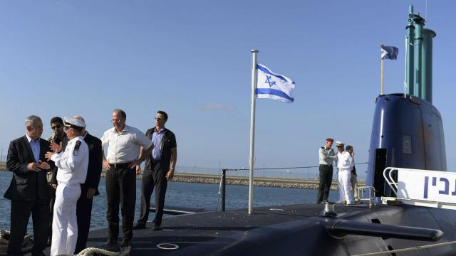 Prime Minister Benjamin Netanyahu, at far left, touring a German-made submarine in Haifa, Sept. 23, 2014. Israel bought German submarines and missile boats. The police say several of the prime minister's associates were bribed to help clinch the deal. (Kobi Gideon/Israeli Government via The New York Times) -- NO SALES; FOR EDITORIAL USE ONLY WITH NYT STORY ISRAEL BRIBERY INQUIRY BY DAVID HALBFINGER FOR NOV. 9, 2018. ALL OTHER USE PROHIBITED. --