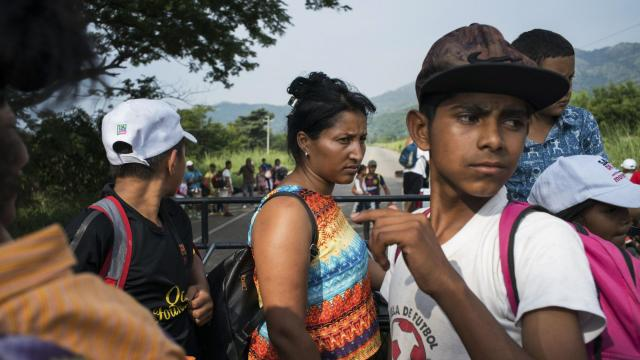 Ani Alvarado, center, and Elmer Jesús Mendoza Banegas travel in the back of a truck en route to San Pedro Tapanatepec, Mexico, Oct. 27, 2018. Alvarado and her family are part of the migrant caravan that began with several hundred participants on Oct. 12 in San Pedro Sula, Honduras, and quickly grew by several thousand as it crossed the border into Guatemala and wound north into Mexico. (Todd Heisler/The New York Times)