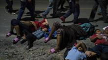 IMAGES: Caravan Walks Quietly On, U.S. Opposition a Distant Rumble