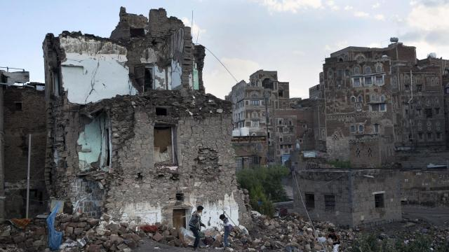 FILE -- Boys play in the rubble of a home destroyed in an airstrike on the Old City of Sanaa, Yemen, Oct. 23, 2018. The Saudi-led war in Yemen has pushed millions to the brink of starvation. (Tyler Hicks/The New York Times)