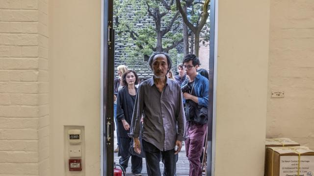 """Ma Jian, an exiled Chinese novelist who lives in London, arrives at a news conference in Hong Kong, Nov. 10, 2018. Ma said the reversal of the decision to cancel his appearance at the Hong Kong International Literary Festival on Saturday """"proves the failure"""" of self-censorship. (Lam Yik Fei/The New York Times)"""