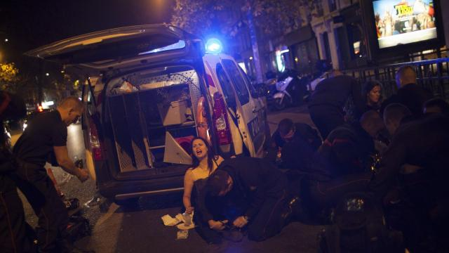 FILE -- A woman is treated after Islamic State militants attacked the Bataclan concert hall in Paris, Nov. 13, 2015. Three years after the terrorist attacks that killed 130 people, films, novels and memoirs allow survivors and others make some sense of what happened. (Pierre Terdjman/The New York Times)