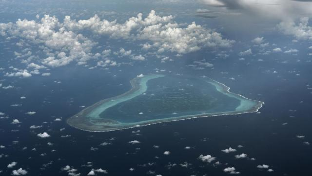 FILE -- The Scarborough Shoal, which was previously administered by the Philippines before being claimed by China in 2012, in the South China Sea, Sept. 5, 2018. Trump administration officials are anxious about Beijing's efforts to assert dominance over Taiwan, the South China Sea and far Pacific islands. They say the U.S. needs to push back. (Adam Dean/The New York Times)