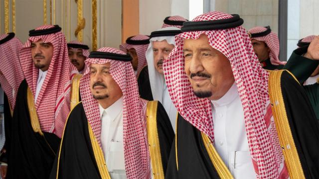 In a photo provided by the Saudi Royal Palace, King Salman of Saudi Arabia, right, arriving to inaugurate the Shura Council new session, in Riyadh, Saudi Arabia, Nov. 19, 2018. King Salman stood by his son and crown prince, Mohammed bin Salman, on Monday, avoiding any mention of the international outrage toward the kingdom in his first public remarks since Saudi agents killed the dissident journalist Jamal Khashoggi in Istanbul last month. (Bandar Algaloud/Saudi Royal Palace via The New York Times) -- NO SALES; FOR EDITORIAL USE ONLY WITH NYT STORY SAUDI-JOURNALIST-KILLING BY BEN HUBBARD AND CARLOTTA GALL FOR NOV. 19, 2018. ALL OTHER USE PROHIBITED. --