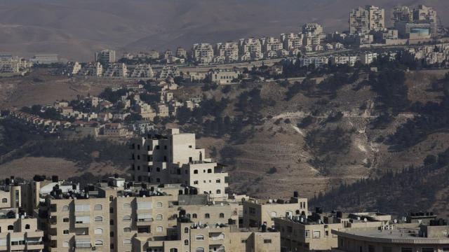 """FILE -- The Israeli settlement of Maale Adumim overlooks Al Z'aim, a Palestinian village in the West Bank, Oct. 26, 2016. The home rental site Airbnb acceded to demands that it no longer list accommodations in Israeli settlements, citing """"the dispute between Israelis and Palestinians."""" (Rina Castelnuovo/The New York Times)"""