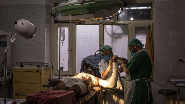 FILE -- A wounded commando undergoes surgery in Jaghori, Afghanistan, Nov. 11, 2018. American forces experienced the worst loss of life so far this year in Afghanistan when three soldiers were killed in a Taliban bombing on Nov. 27, 2018. Three more soldiers and an American contractor were wounded. (Jim Huylebroek/The New York Times)