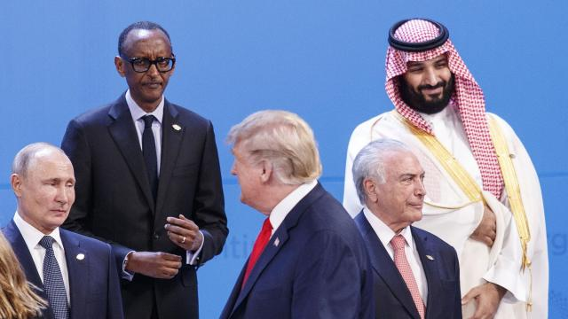 President Donald Trump, center, walks past President Vladimir Putin of Russia, left, and Crown Prince Mohammed bin Salman of Saudi Arabia, right, while lining up with world leaders for a group photo at the G-20 summit, at the InterContinental hotel in Buenos Aires, Argentina, Nov. 30, 2018. At the Group of 20 gathering in Buenos Aires, Trump declined to meet with his two favorite strongmen, postponed meeting an ally and was preoccupied with the Russia investigation. (Tom Brenner/The New York Times)