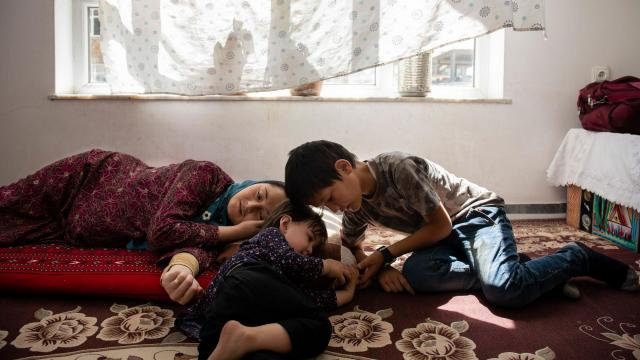 Just months after her husband was killed, Rahila Shams was expecting another child and lay in the early stages of labor with their daughter, Sofia, center, in Kabul, Afghanistan, Aug. 3, 2018. The war in Afghanistan is disproportionately killing young men, leaving behind women with limited options. (Kiana Hayeri/The New York Times)