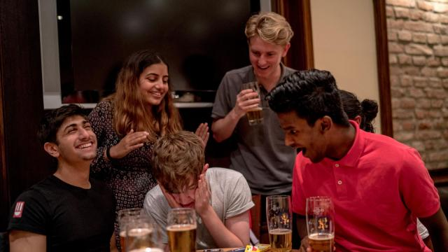 Alfie Clarke, center left, and his friends react as they lose an online film quiz at a youth hostel in Munich, Germany, Aug. 30, 2018. Much has changed in the 46 years since Interrail pass was introduced, but the essence of what it offers — experiencing new cultures and meeting new people — has remained the same. (Andrew Testa/The New York Times)