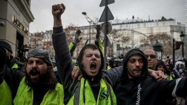 Macron promises minimum wage hike in response to violent protests in France