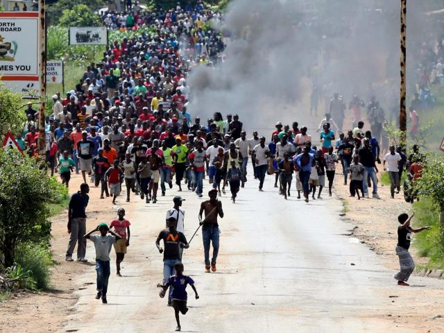 Zimbabwe protests turn violent after fuel prices more than double