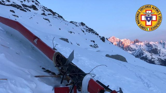 Five people were killed and two injured after a helicopter and a small plane collided Friday above a glacier in the Italian Alps. (@cnsas_official/Twitter)