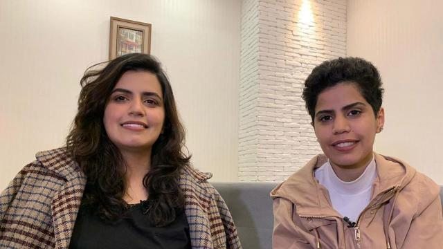 Maha Zayed al-Subaie 28, left, and her sister, 25-year-old Wafa, are photographed on April 18 during an interview with CNN, after applying for asylum in Georgia. (Sophiko Vasadze/CNN)