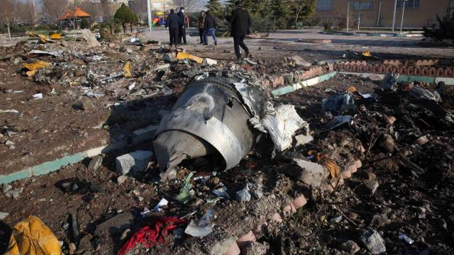 Iranians clear crash site of wreckage, as calls for transparent investigation grow