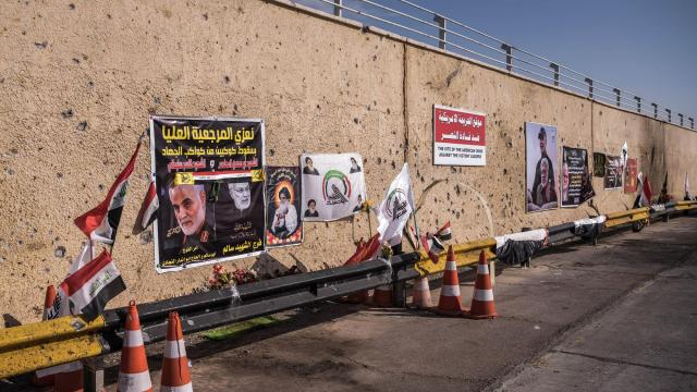 FILE -- Memorials at Baghdad International Airport, where General Suleimani, a senior commander in the Islamic Revolutionary Guards Corps, and other Iranian and Iraqi officials were killed on Jan. 9, 2020, in Baghdad. Iran has issued an arrest warrant for President Trump and 35 other people it says were involved in a drone strike that killed a top Iranian general in Baghdad earlier this year and has asked for international help in detaining them, according to Iranian news reports. (Sergey Ponomarev/The New York Times)