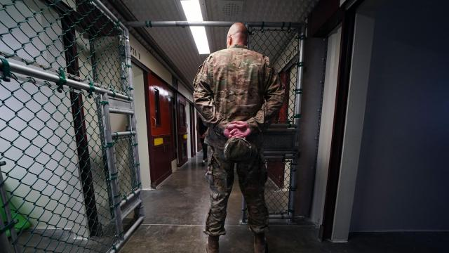 **EDS­: PHOTO HAS BEEN REVIE­WED BY U.S. MILIT­ARY CENSO­RS.** -- FILE -- A member of the U.S. military stands at ease during a media tour of the detention center at Guantánamo Bay, Cuba, on April 17, 2019. The first 100 members of the prison staff at Guantánamo Bay have received initial vaccines against the coronavirus, the U.S. military said on Tuesday evening, Jan. 12, 2021, though it declined to say whether any of the 40 wartime prisoners at the detention center were offered or received vaccines. (Doug Mills/The New York Times)