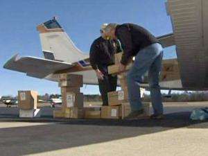 Volunteers load a plane with medical supplies on Jan. 18, 2010, after the N.C. Conference of the United Methodist Church collected 19 tons of goods for earthquake-ravaged Haiti.