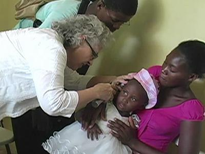 A volunteer with Durham-based Family Health Ministries treats a child at a clinic in Haiti, still recovering 18 months after a massive earthquake rocked the small country.