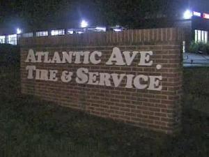 A worker who stopped by Atlantic Tire with his son found two members of a cleaning crew on the floor late Saturday, June 30, 2007.