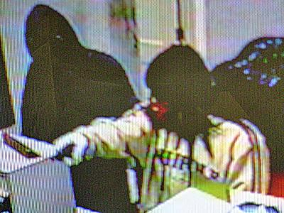 Three armed men entered a bank in Vass and demanded money from a teller.