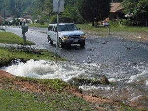 Residents said that a water-main break damaged houses and yards in a Fayetteville neighborhood overnight July 14. (Photo courtesy of a resident of Louise Street)