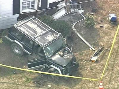 Jeep Slams Into House; Mom, Children Injured