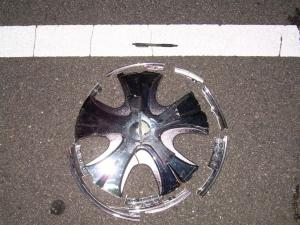 This 15-inch after-market chrome spinner hubcap was found near the crash site and might have come from the vehicle, police said.