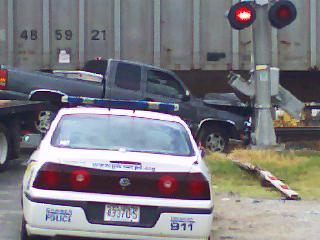 This truck got stuck underneath a train after its driver attempted to beat the train over a crossing in Garner on Friday, September 14.