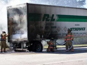 A tractor-trailer carrying paint and pesticides caught fire Monday morning at a rest stop on Interstate 95.
