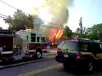 Mary Settles took a picture with her cell phone of the house fire in Wake Forest