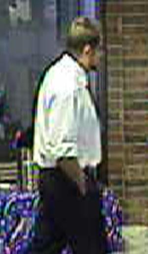 Fraud detectives are trying to identify this man, who is wanted for scamming an elderly woman out of $14,000 on Oct. 11.