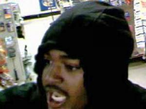 Surveillance photos of a man Raleigh police believe might have committed two armed robberies within 23 minutes of each other late Sunday, Nov. 4, 2007.