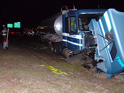 A tractor-trailer and two vehicles collided at about 12:30 a.m. Thursday on U.S. Highway 70.