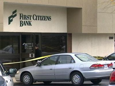 Crime scene surrounds the First Citizens Bank at Wade Avenue and Ridge Road Tuesday after a robbery.