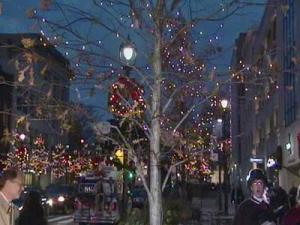 Raleigh Mayor Charles Meeker threw the switch to light up Fayetteville Street for Christmas on Friday.