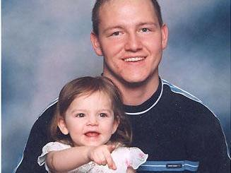 Cpl. Tanner J. O'Leary, 23, of Eagle Butte, S.D., with his daughter Alexis. O'Leary was killed in combat in Afghanistan on Sunday, Dec. 9, 2007.