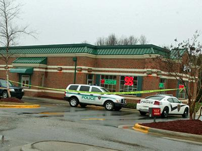 Holly Springs police park outside Wendy's restaurant at 325 N. Main St. which was robbed on Jan. 18, 2008.