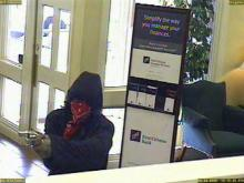 Zebulon police believe Divine Justice Reddick, 23, of Charlotte, committed this robbery at a First Citizens Bank on Friday, Feb. 8, 2008.