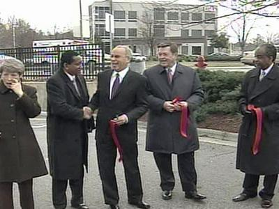 Officials snipped a red ribbon Tuesday, Feb. 12, 2008, to mark the official end of an Interstate 85 widening and rehabilitation project on 8 miles of the highway in Durham.