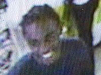 Police released a surveillance photo of a man wanted in connection with a robbery at Uncle Bill's Store.