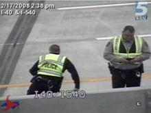 A traffic camera shows Durham police investigating the incident on the Interstate 540 bridge Sunday, Feb. 17, 2008.